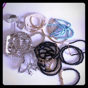 Lots of mix match stackable fashion bracelets